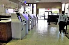 Woman walks toward the digital screens of bank