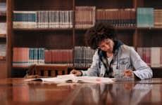 Young student studies in a college library