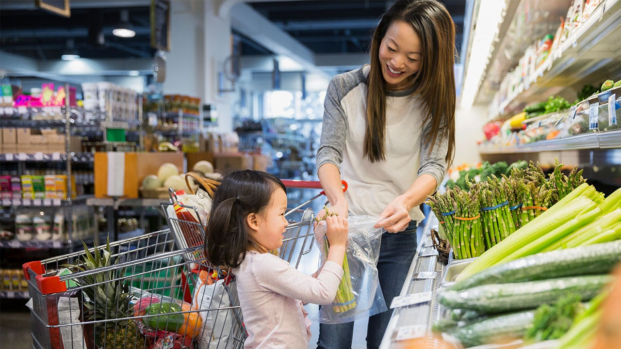Mother and daughter shopping for vegetables