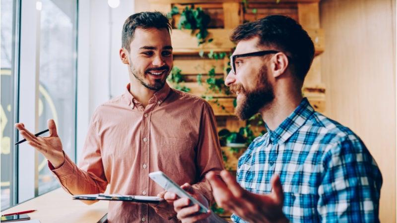 Two young men enjoying a conversation