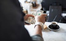 Counting money at a coffeeshop