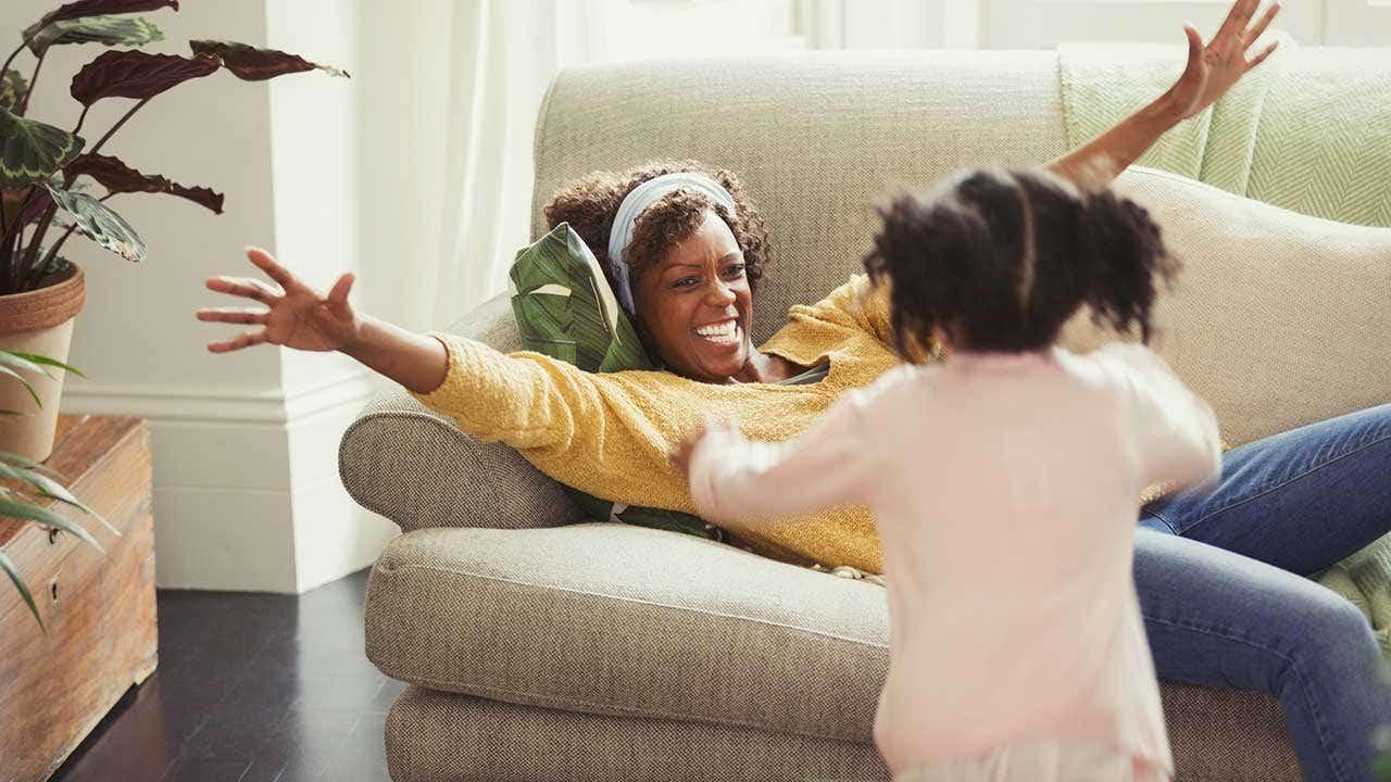 Smiling mom greeting running daughter