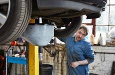 Mechanic looking under car