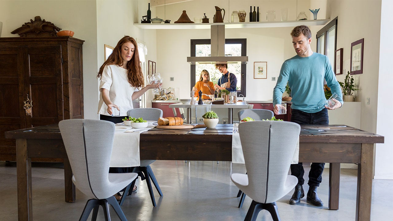Couple setting the table for dinner