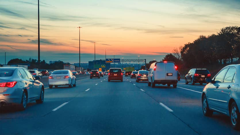 Cars in traffic at dusk
