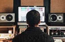 Man mixing music in home studio