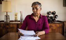Woman reading paperwork