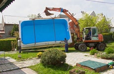 Forklift installing a swimming pool