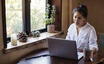 Woman on computer refinancing student loans