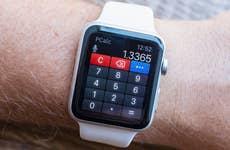 Man using calculator on Apple Watch