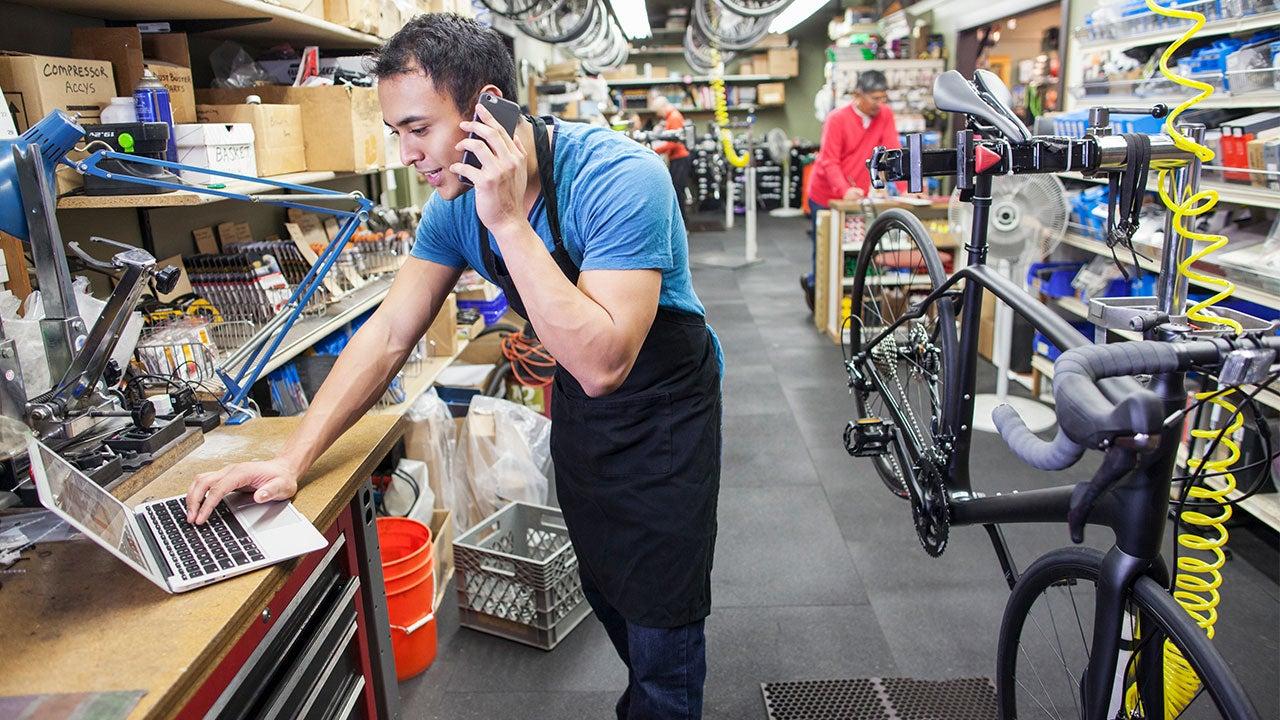Latino man working in a bike shop