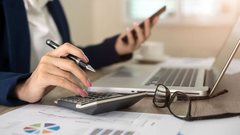 Woman using calculator for taxes
