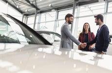 Couple in car dealership
