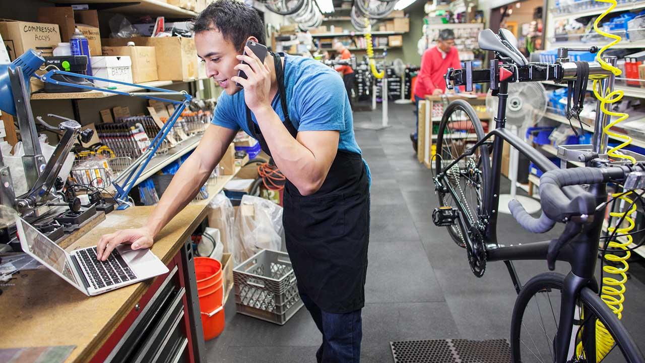 Bike technician talking on cell phone