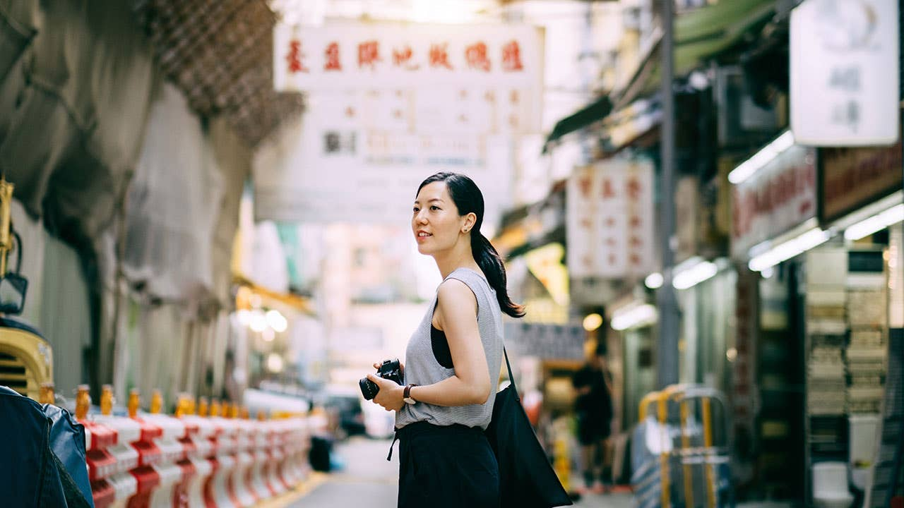 Woman with camera in Asia