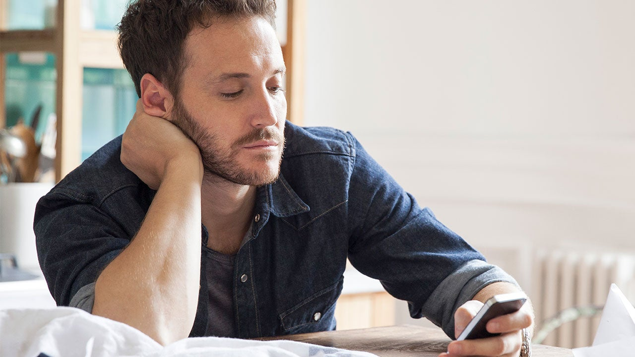 Man browsing the apps on phone
