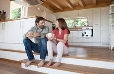 Couple sitting in kitchen