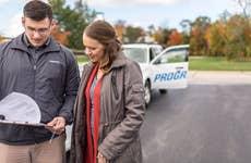 Progressive auto insurance agent reviewing claim