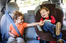 Kids playing in back seat of car