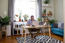 Man in home office online banking