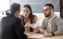 Couple discussing finances with lawyer