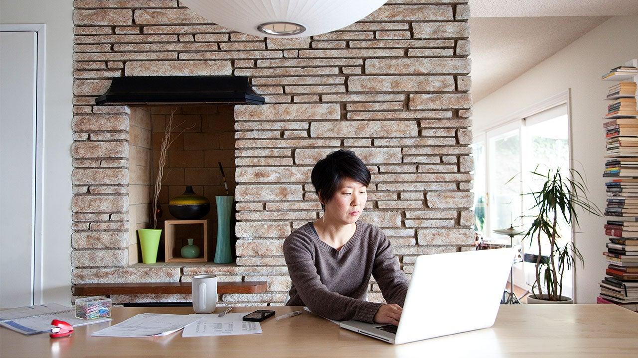 Woman paying mortgage on computer