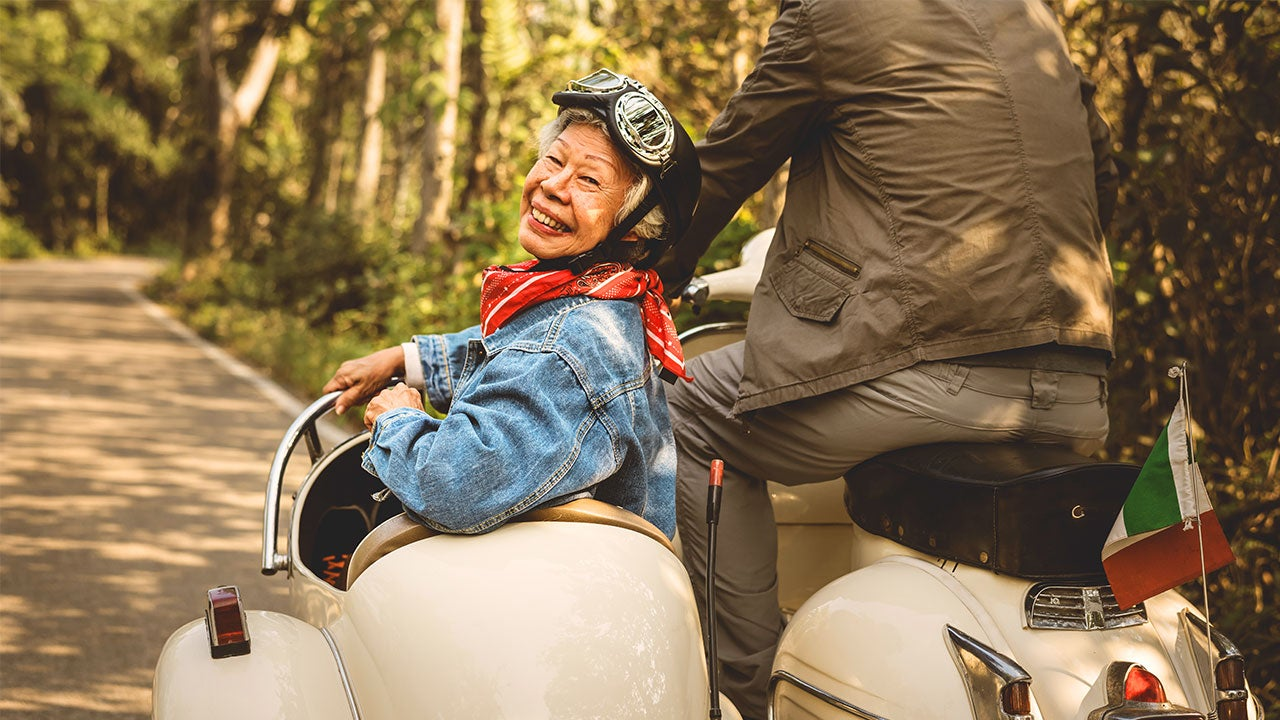 Older husband and wife on a motorcycle