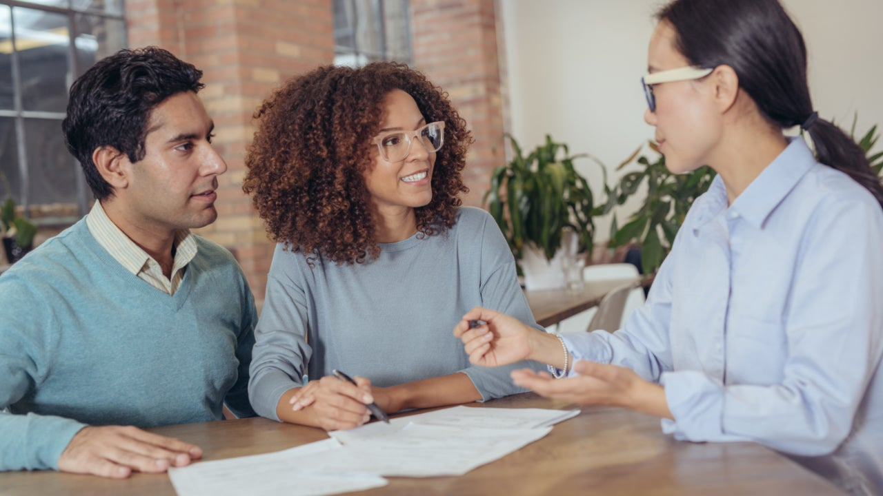 A couple meeting with a mortgage specialist.
