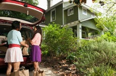 unpacking car in front of home