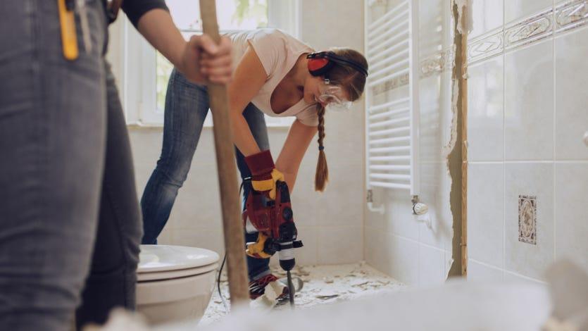 Women renovating a home.