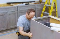 Man works on remodeling a kitchen
