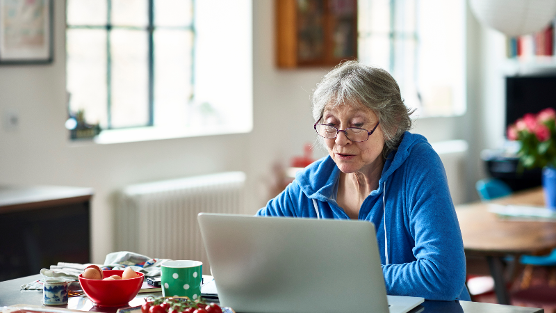 old woman working on her computer
