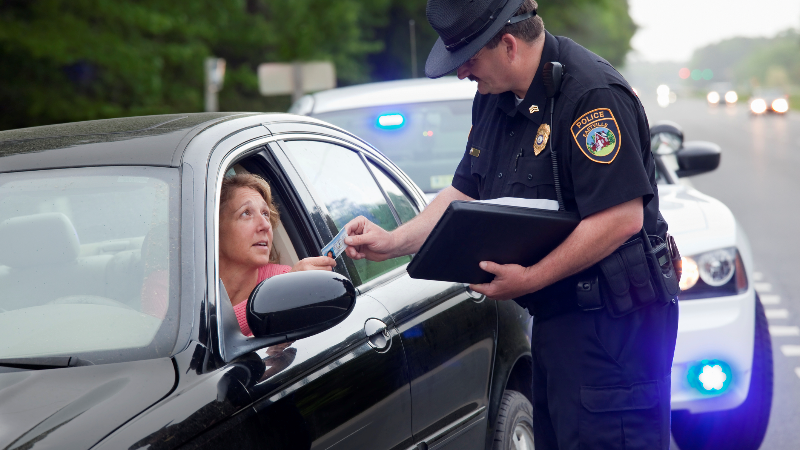 policeman pulling a woman over