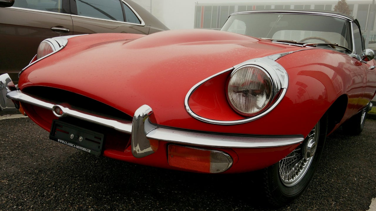 Close-up of a red, classic car.