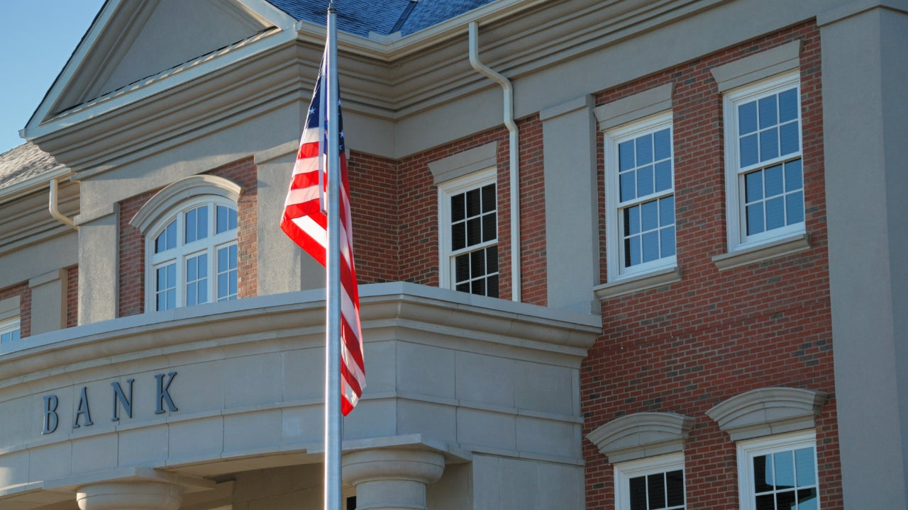 Outside view of a bank with American flag