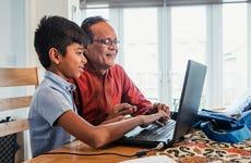 Grandfather and grandson on computer