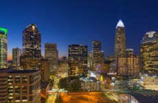 The evening skyline of Charlotte North Carolina all lit up.