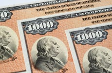 A picture of several U.S. savings bonds