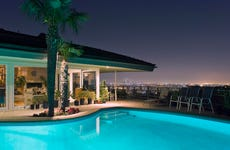 Illuminated pool at night with city in background, Los Angeles, California