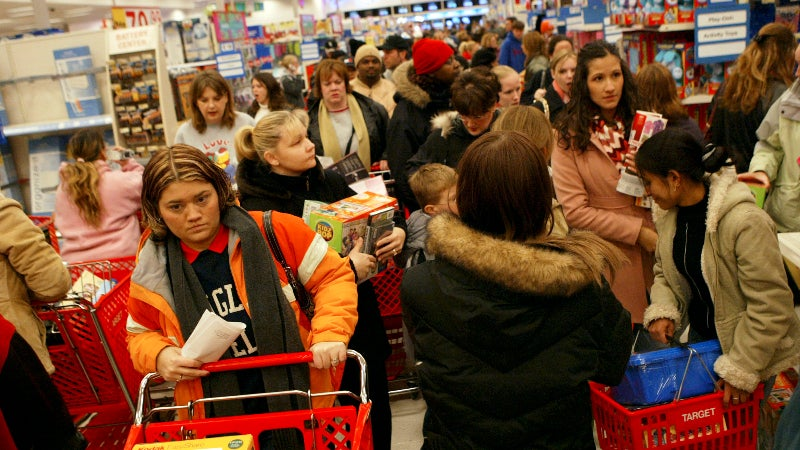 shoppers in a store on black friday