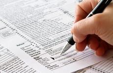 woman signing tax returns