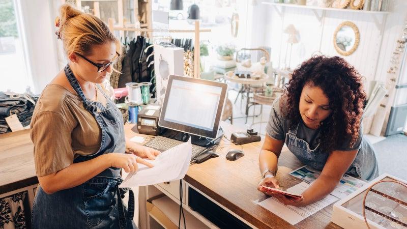 colleagues discuss financial receipts checkout