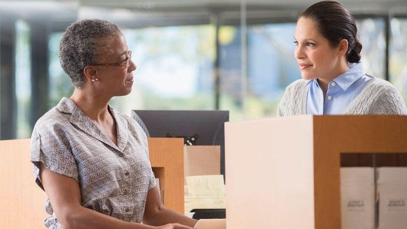 Woman at bank talking to teller