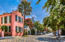 Historic buildings down a cobblestone street in Charleston, South Carolina.