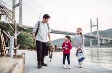 Young family go fishing together joyfully