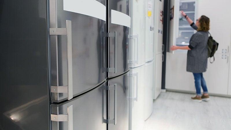 Woman buying refrigerator appliance