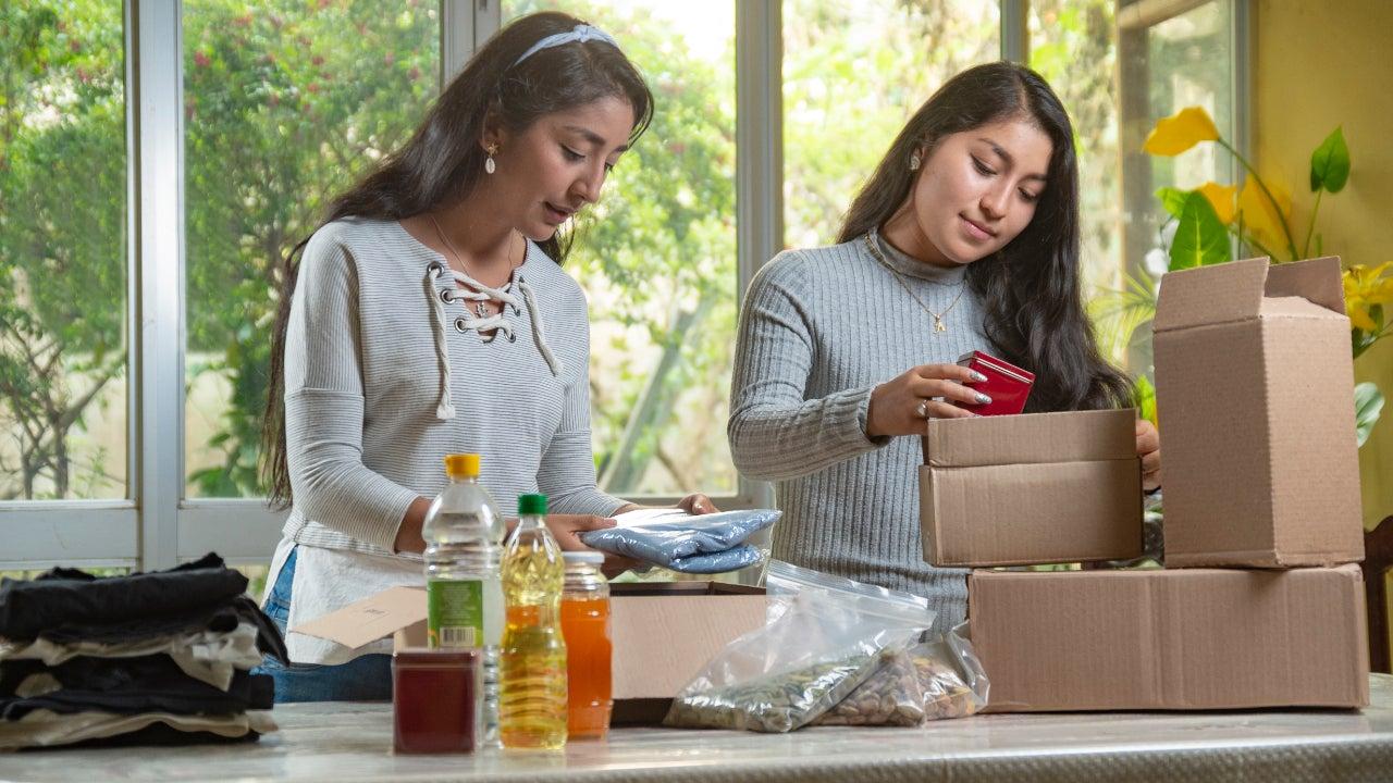 Women preparing charity boxes