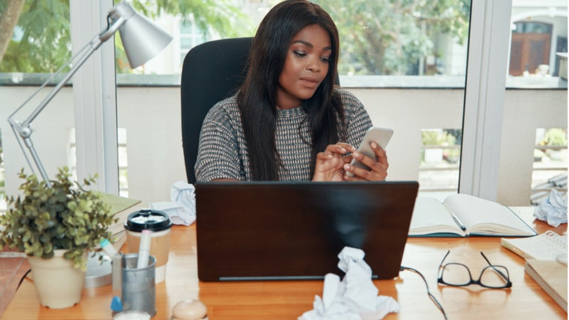 African American businesswoman working on laptop