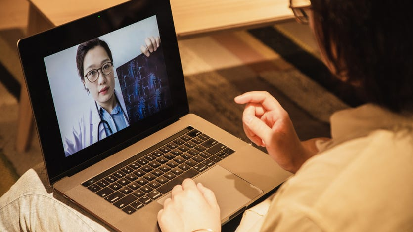 Consulting doctors online using laptop