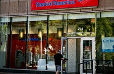 A customer enters a Bank of America location
